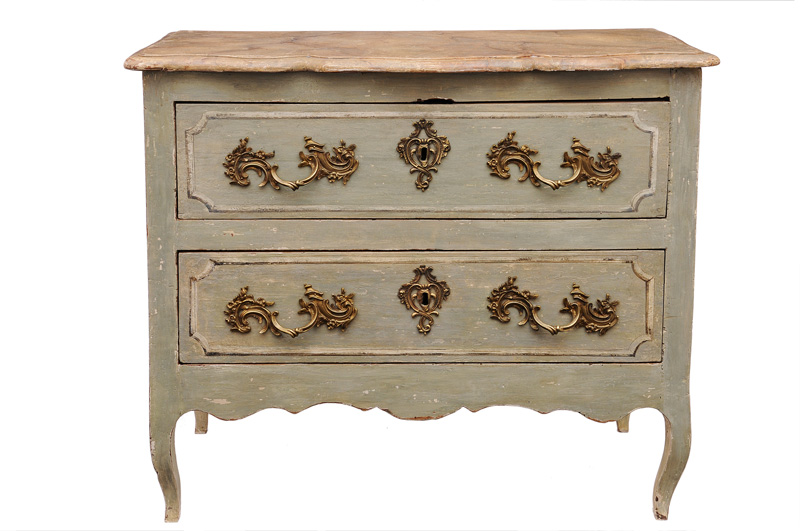 A coloured Louis Quinze chest of drawers
