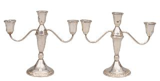 A pair of table candleholders