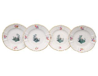 A set of four plates with Watteau scenes