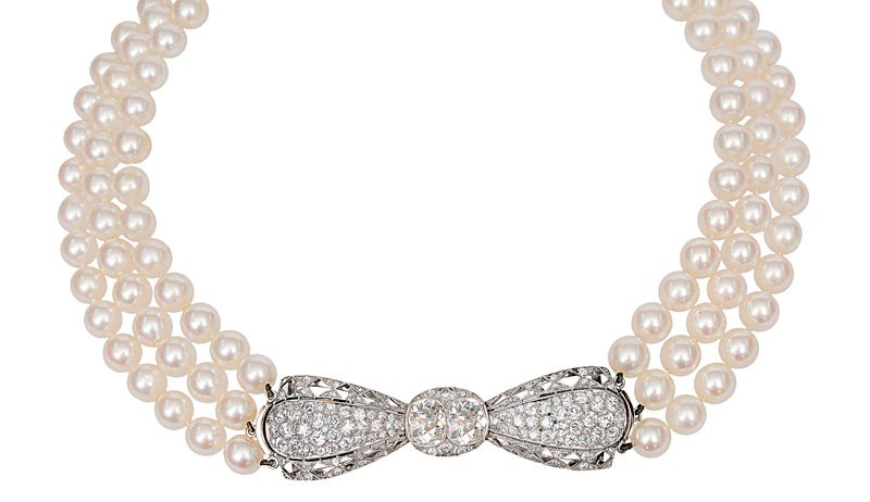 A pearl necklace with antique diamond clasp