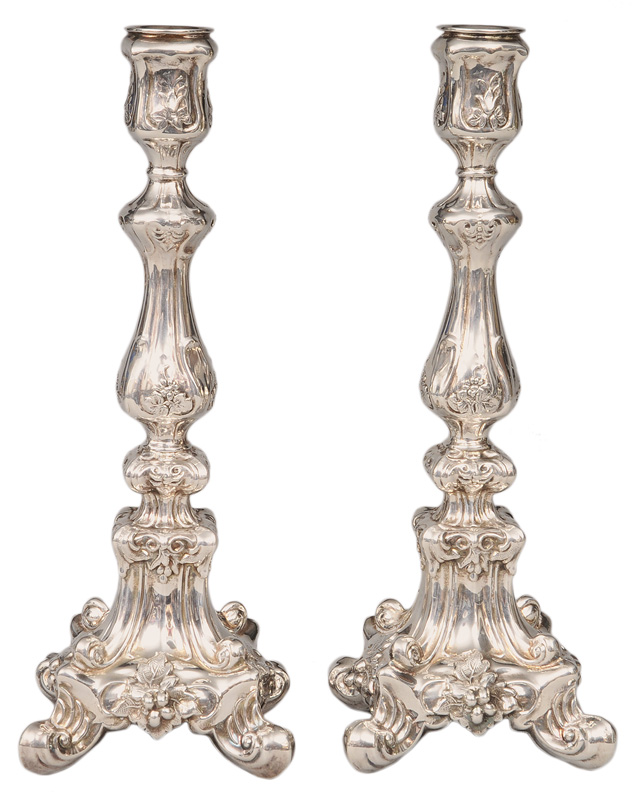 A pair of large candlesticks in the style of Baroque