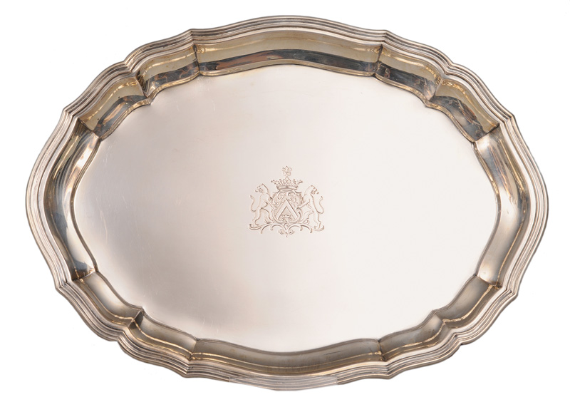 An oval tray with engraved coat of arms of the Family Roux