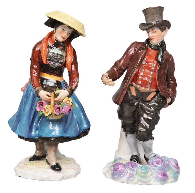 A pair of traditional costume figurines