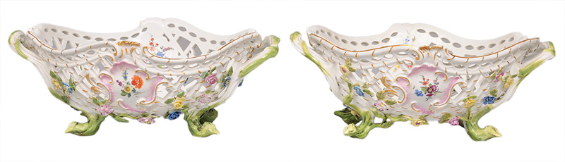 A pair of fretwork baskets with flower decoration