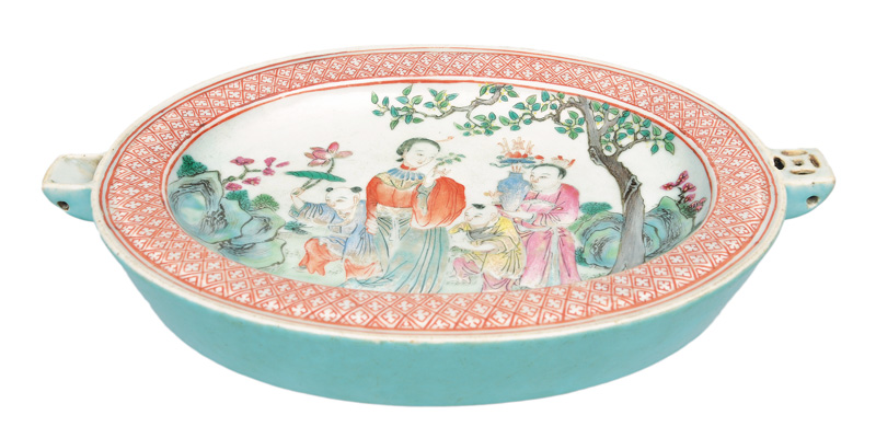 A Famille-Rose heating plate with garden scene