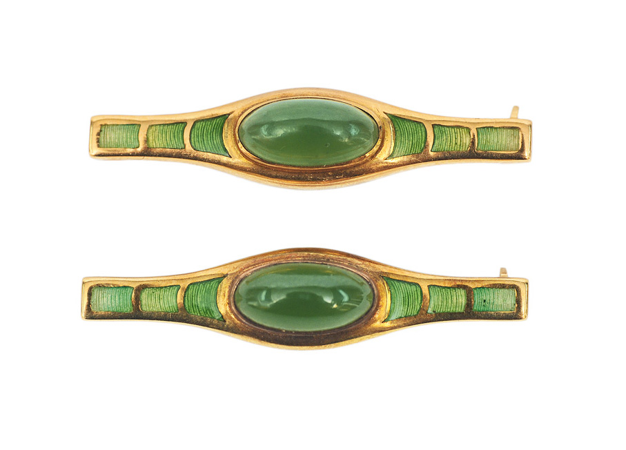 A pair of brooches with beryl and enamel