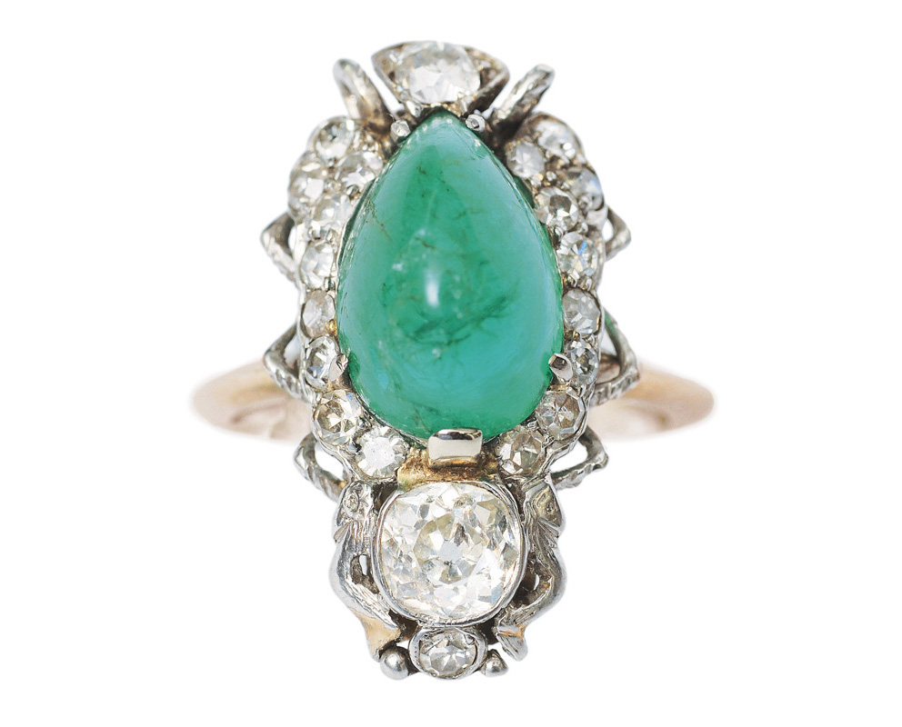 An Art-déco ring with emerald and diamonds