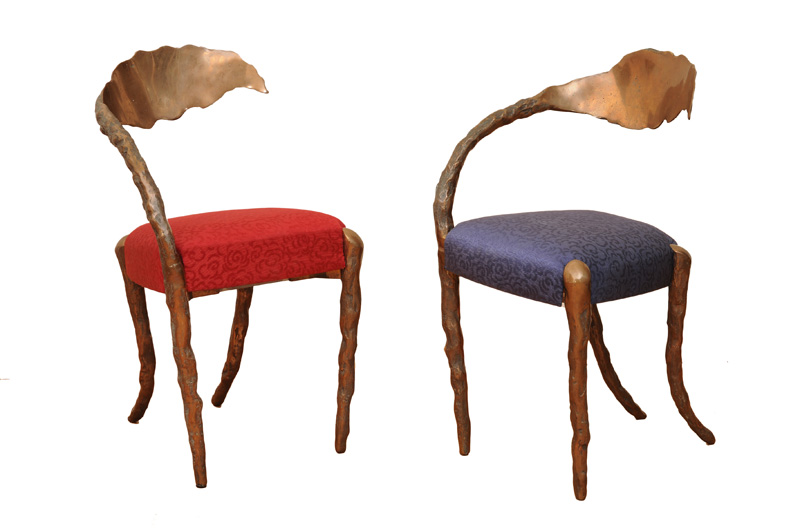A pair of sculptural bronze chairs