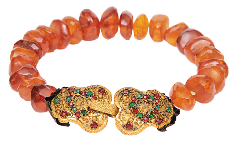 An antique amber necklace with traditional clasp