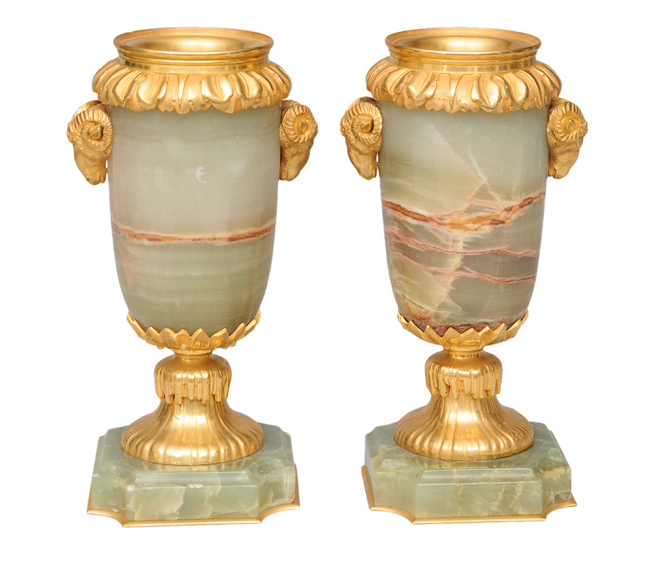 A pair of decorative bronze and onyx vases