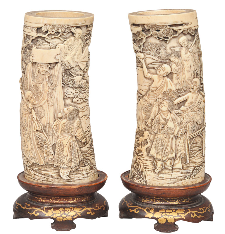 A pair of fine ivory brushpots with mythological scenes