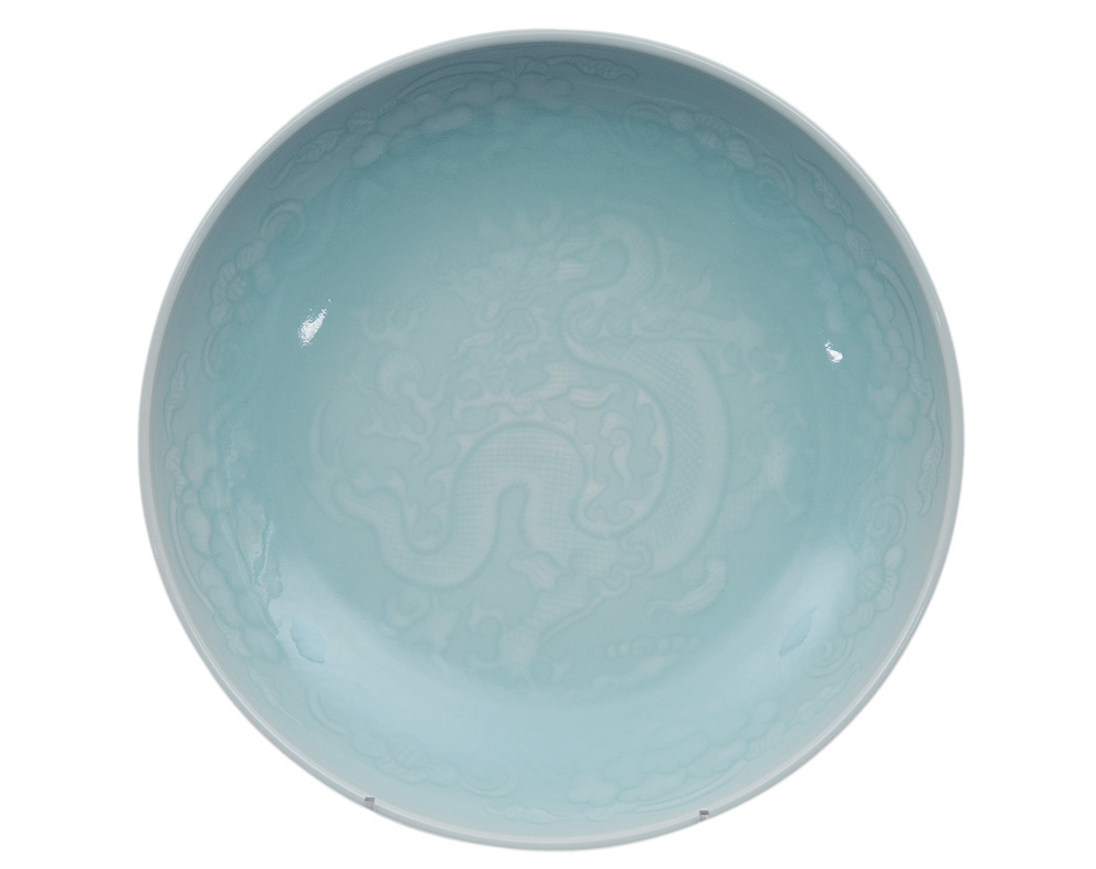 A fine celadon plate with dragon decoration