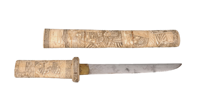 A bone-mounted Aikuchi with figural relief scenes