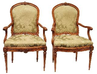A pair of Louis Seize armchairs with fine carved decor of rosettes an foliage