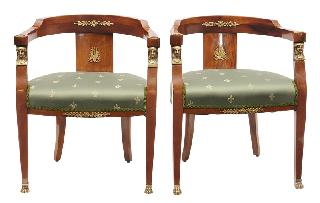 A pair of armchairs in the style of Empire