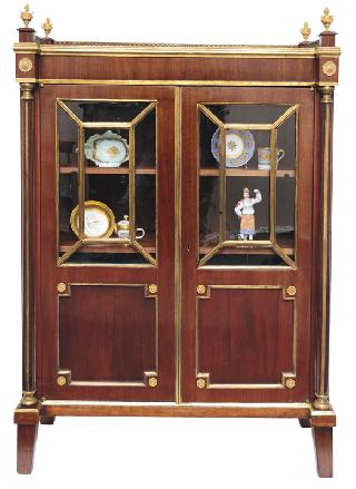 An elegant Empire glass cabinet