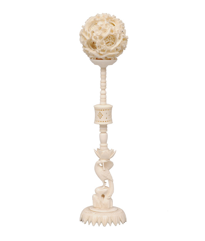 An ivory contrefait ball on stand