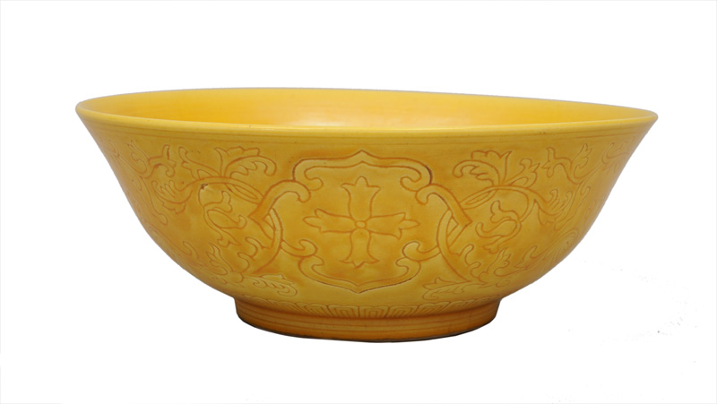 A yellow bowl with flower decoration