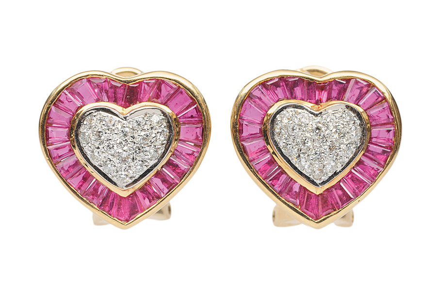 A pair of heartshaped ruby diamond earclips