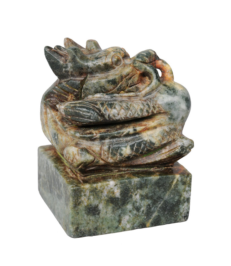 A large jade seal with dragon