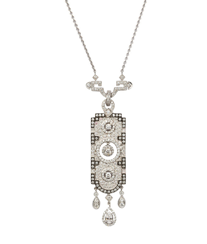A diamond pendant with necklace in the style