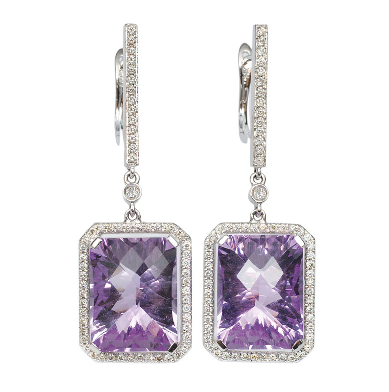 A pair of amethyst diamond earrings