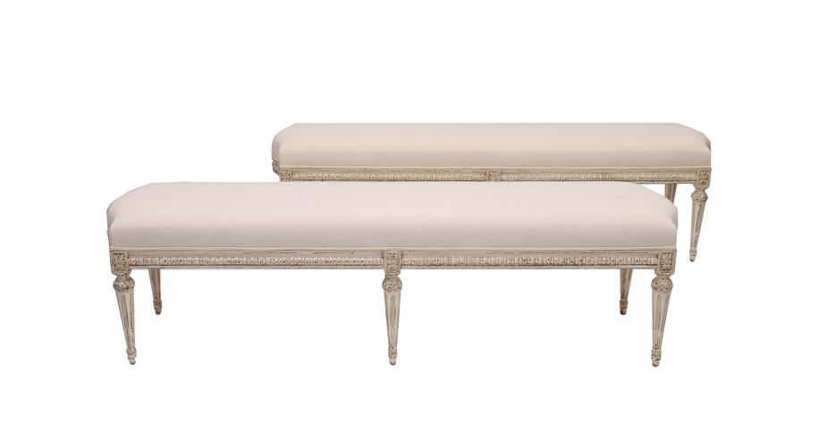 A pair of benches in the style of Louis Seize