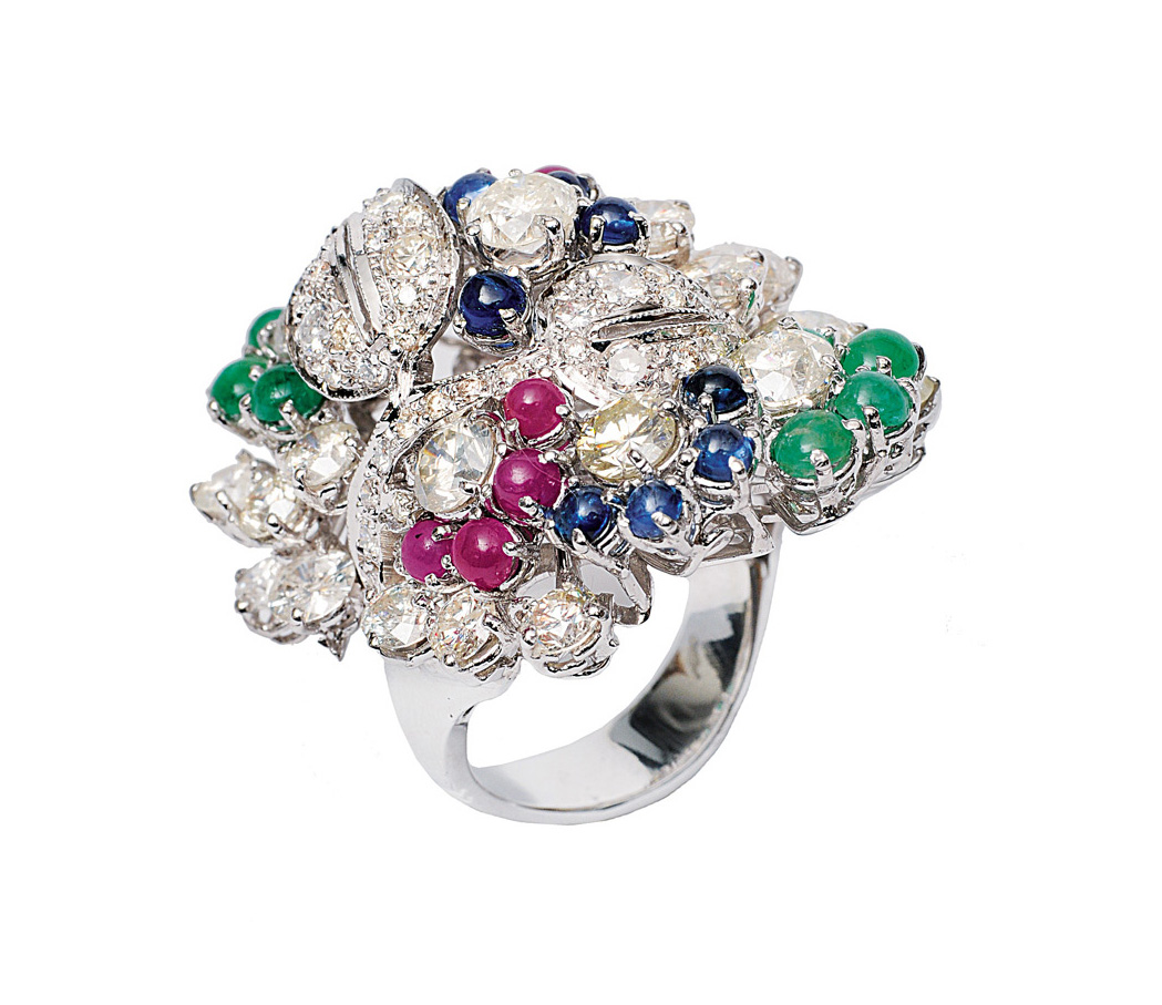 A highcarat diamond ring with emeralds, rubies and sapphires