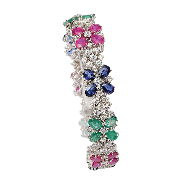 A colourful bracelet with diamonds, sapphires, rubies and emeralds