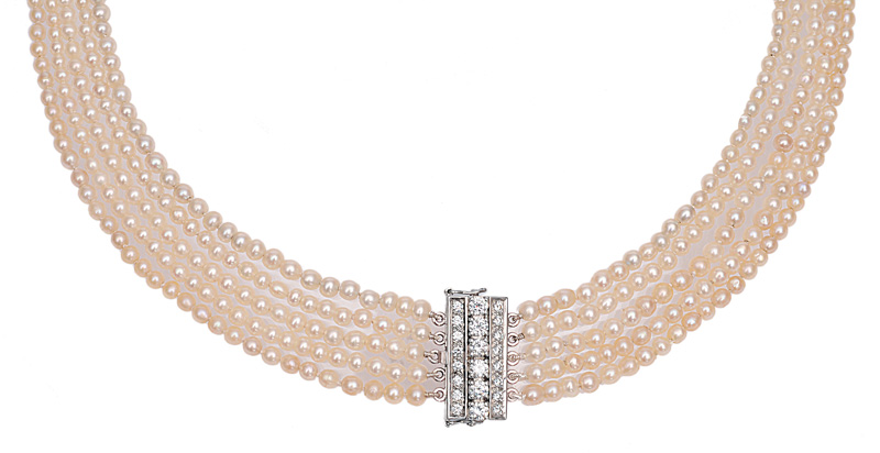 A natural pearl necklace with diamond clasp