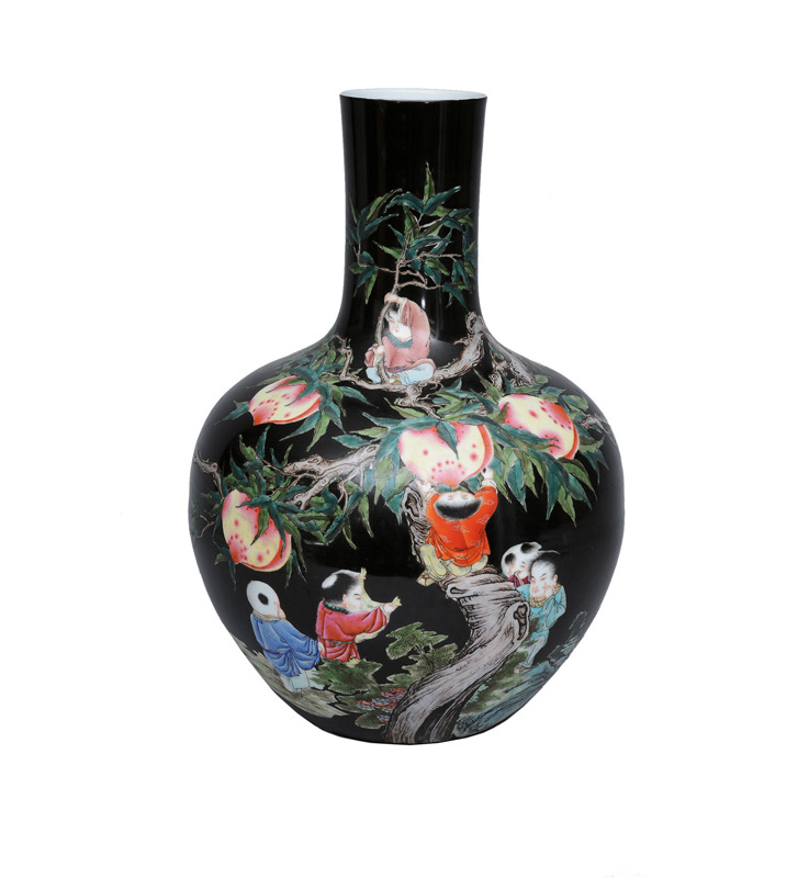 "A magnificent ""Famille-Noire"" vase with boys and peaches"