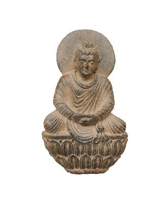 A grey chist figure of a Gandhara-Buddha on a lotus throne
