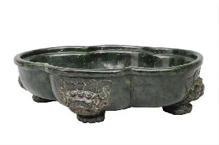 An exceptional large and impressive spinach green jade bowl
