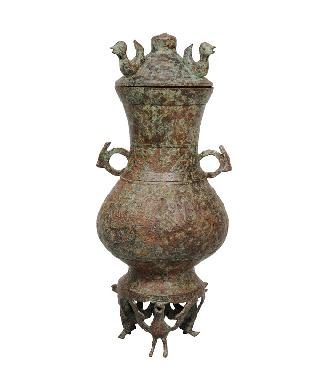 "A rare archaistic bronze vase ""HU"" with bird base"