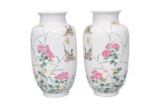 A pair of fine rouleau vases with grey gooses