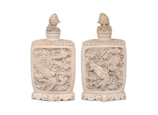 A pair of fine ivory snuffbottles with dragon and phoenix