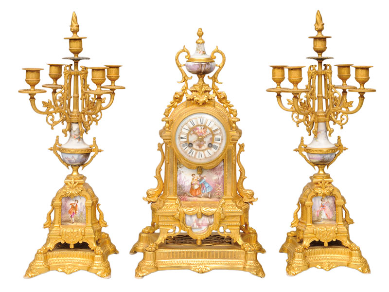A mantle clock with a pair of candle holders with porcellain application
