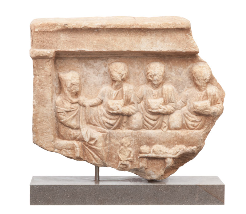A roman fragment of an antique votive relief 'Familiy meal'