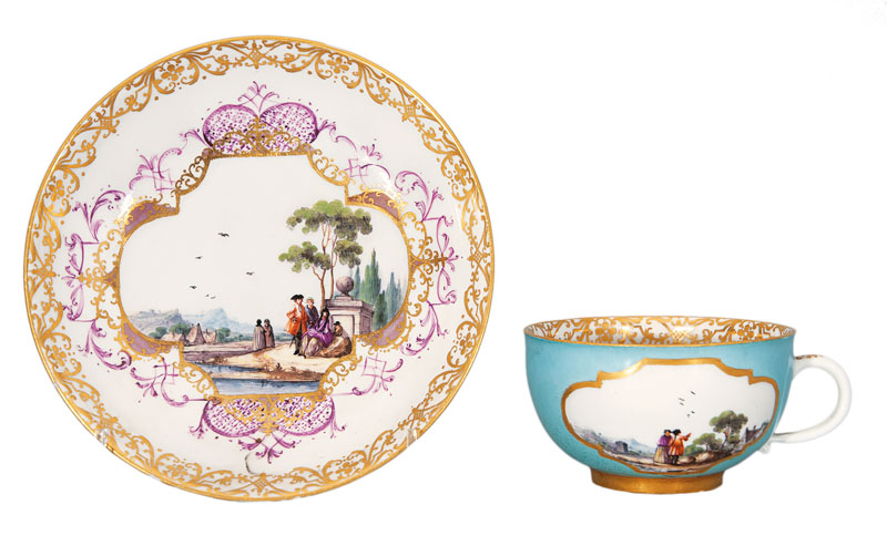 A yellow-ground cup and saucer with Kauffahrtei- and landscape scenes