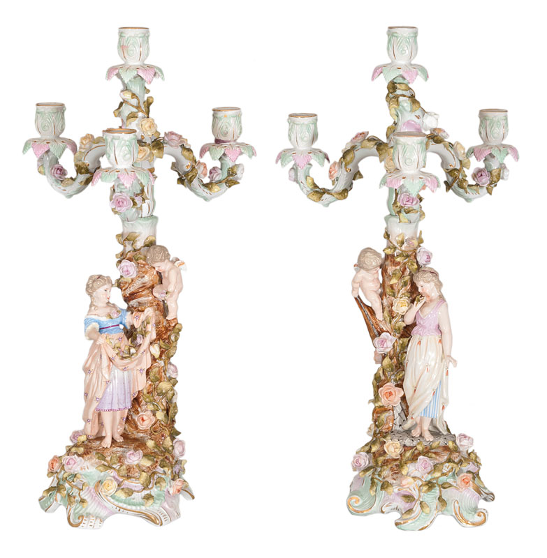A pair of tall candelabra with allegorical figures