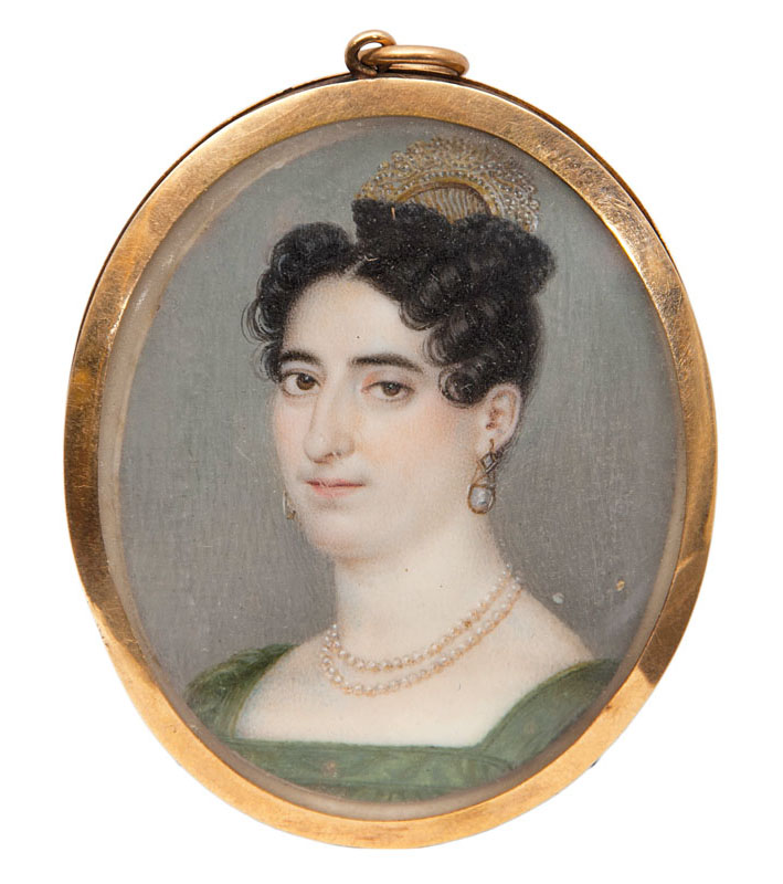 A Georgian miniature portrait of a lady with pearlnecklace