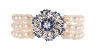A pearl bracelet with a sapphire diamond clasp