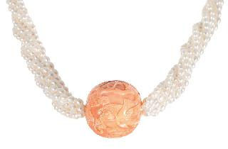 An antique coral with chinese carving on pearl necklace