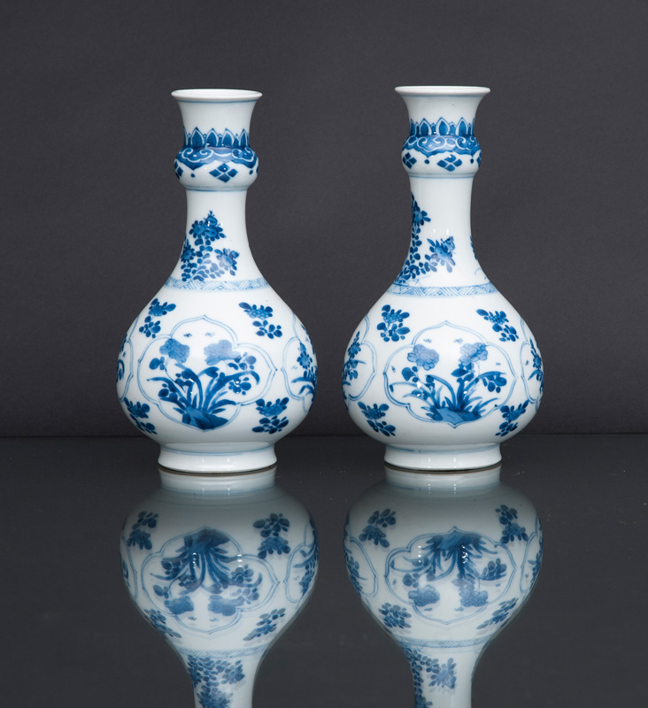 A pair of small bottle vases with flower decoration