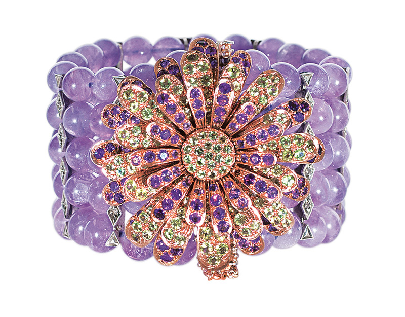 An amethyst peridot bracelet with splendid flowershaped clasp
