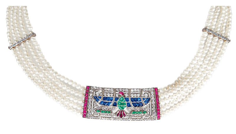 A pearl necklace with precious clasp 'Horus Hawk' in the style of Art-Déco