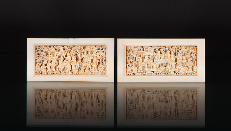A pair of fine Canton ivory plaques with genre scenes