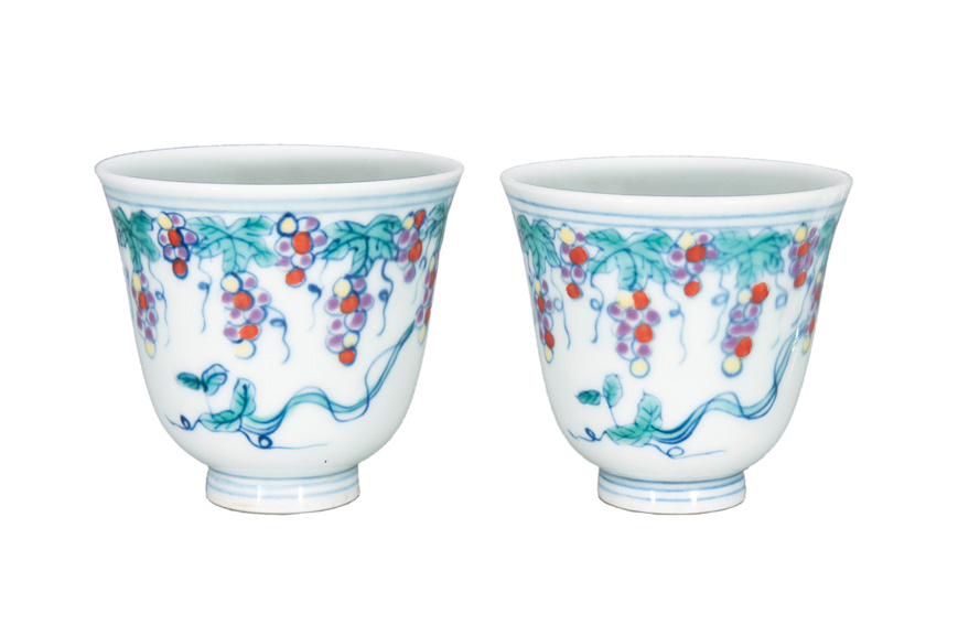 A pair of fine Doucai cups with grapevine