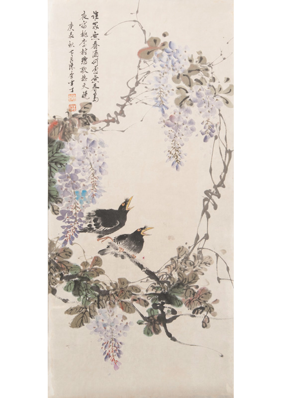 A pair of blackbirds on a wisteria branch