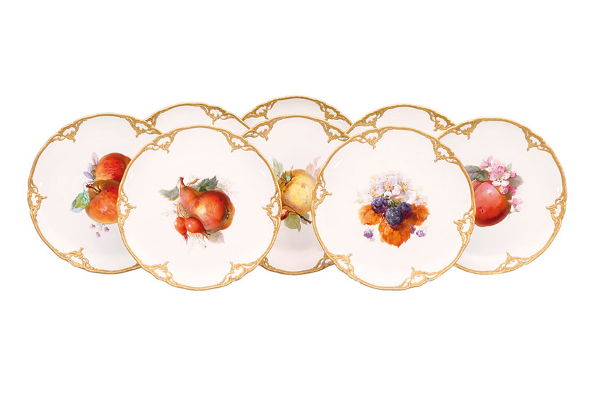 A set of 8 fruit plates with rocaille decoration